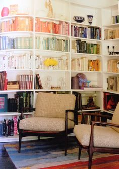 "neutral books at eye level- colorful books above head, dark stuff at floor level. From Sunset's ""The Organized Home"" issue."
