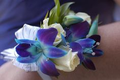 Corsage my son gave his prom date. Blue orchids & baby white roses.