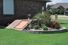 Storm shelter integrated into the landscaping.