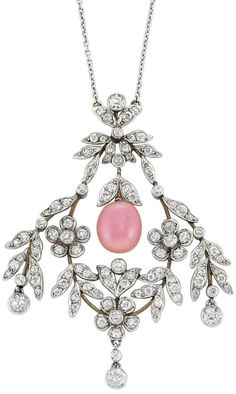 Belle Epoque Platinum, Gold, Conch Pearl and Diamond Lavaliere  Suspending one oval conch pearl approximately 9.0 x 7.5 mm., capped by diamond-set leaves, within an openwork garland motif, set throughout with old European-cut diamonds, circa 1905, completed by a delicate platinum chain.