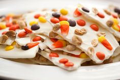 Make this white chocolate Halloween bark in under 5 minutes—you'll love the sweet and salty combo of the Reese's pieces and peanuts.