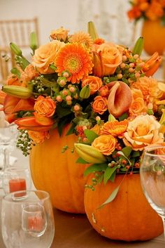 flowers in pumpkins. really like this - gorgeous idea for a fall wedding centerpiece