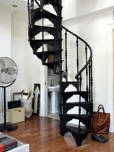 Courtney Wotherspoon's home via Design Sponge: the wrought-iron spiral staircase weighs in at one ton and runs from the living room to the loft bedroom above.
