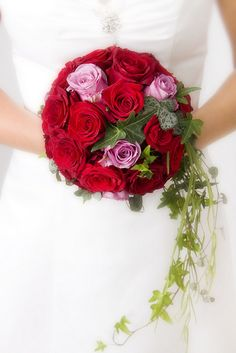 This is a beautiful rose wedding bouquet composed of Roses and Ivy greens. Premade Wedding flowers can be beautiful and affordable. To view more online wedding arrangements visit us at www.bunchesdirect.com