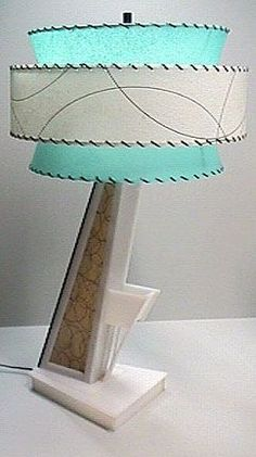 Vintage Early 50s NEW & MODERN Lamp of this Era;  This was something NEW, Never Seen Before, From the Modern Angling of the Base of the Lamp with the Matchbook Holder Built on, to the Fabulous Double Layer Fiberglass Lampshade.  You Either Loved this New Look or Hated it.  NOW, it is Very Collectible and brings good Values at Auction or Tag Sales.