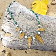 Green Aventurine and Crazy Lace Agate Necklace $26     This fun necklace measures 20-inches and has an organic, tribal look. The shades of the Green Aventurine beads bring out the colors in the Crazy Lace Agate spikes accented by 10mm Cream Quartz rondelles.