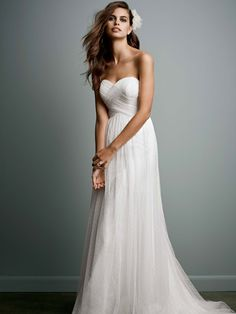 Long and soft, this delicate Galina gown is simply gorgeous. Swiss Dot Tulle Empire Waist Wedding Dress, Style WG3438.