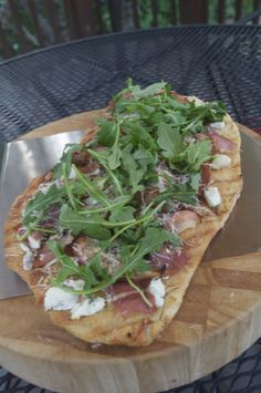 Pear, Prosciutto, and Arugula Pizza done on the Grill. The sweet of the grilled pear, the salt of the prosciutto, the spice and crunch of the arugula plus the crispy crust make for a patently perfect pizza.    Click the pic for step by step, pic by pic, fool proof instructions so you can do this too...