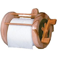 The Fishing Reel Toilet Paper Holder is the perfect gift for any fisherman (or woman).  They'll be able to practice their hobby while doing their business!  Also make a great accessory for the boat or cottage.  The Fishing Reel Toilet Paper Holder is made from solid wood with brass side plates and even features a built-In clicker so that when you turn the handle you'll feel like you're reeling in the big one!