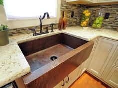 Worst Kitchen in America III: Kitchen Crashers to the Rescue: The new kitchen fairly sparkles dressed out with quartz countertops, a copper farmhouse sink and designer faucet in coordinating brushed copper. From DIYnetwork.com