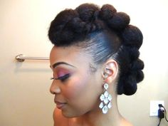Natural updo faux hawk with twisted front pompadour. Elegant hairstyle!