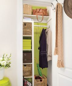like that there's color on the wall and ikea shelves in this cute little hall closet