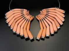Upcycled Barbie doll parts jewelry.  I'm sorry but that's super creepy....