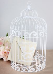 "Looking for a unique and chic place for guests to drop their cards on your special day? This pretty white birdcage will decorate your gift table with its whimsical and airy design.  Features and Facts:  Measures: 16"" H x 9"" W.  Can be used as decor after the wedding.  Birdcage is white in color and made of metal. #DBBridalStyle"