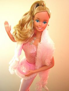 Pretty in Pink Barbie. Loved her pink fur stole!