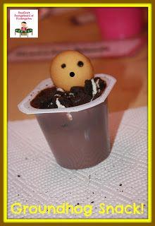 Groundhog in his burrow snack!