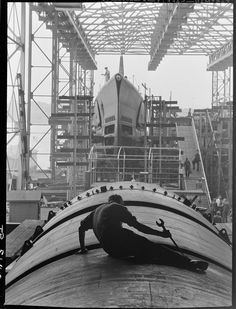 """oleggin:    """"Man working on hull of U.S. Submarine at Electric Boat Co., Groton, Conn."""" By Charles Fenno Jacobs, August 1943  From the exhibit: THE WAY WE WORKED by the National Archives."""