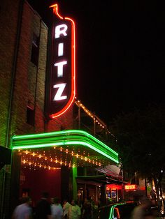 Wind down with dinner and a movie at The Ritz Alamo Drafthouse #sxsw neon sign, austin texas