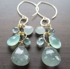 Beautiful detailed faceted multi colored natural moss Aquamarine and aqua Chalcedony gemstones are hanging in a cluster from 14k gold filled chain and hoops.Colors include 4 shades of blue.Size approx. 3 inches long including ear wires