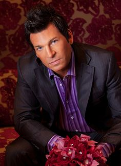 I am SO in love with David Tutera! I would give anything to have him take over my wedding. He's such a dream.