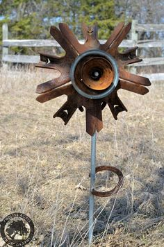 Awesome metal flower by Roosters Creations (located in Wisconsin)   http://thepinkhammerblog.com/2013/04/26/roosterscreations/