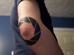 Elbow Triangles Tattoo or what I like to call an Aperture science logo