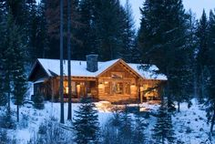 Log cabin off in the snow covered woods.