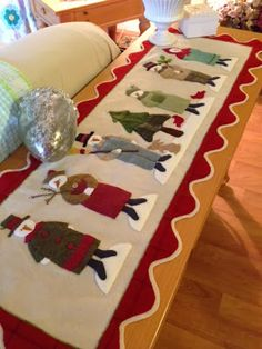 Seven snowmen table runner by Brenda Riddle; design by Bonnie Sullivan