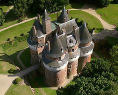 Château de Rambures, Rambures, Somme, France....  http://www.castlesandmanorhouses.com/photos.htm .... The château was constructed in the Middle Ages in the style of a military fortress of the 15th century. It was one of the first castles in Europe to be constructed almost exclusively in bricks. The castle has been classified as a monument historique by the French Ministry of Culture since 1927.