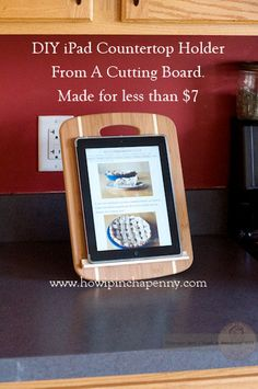 DIY iPad Cutting Board holder from How I Pinch A Penny.com