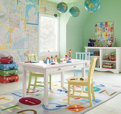 Travel-themed playroom - wall art above shelves