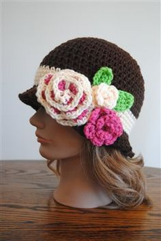 This free crochet hat pattern would be adorable on a little girl.  Red Heart Spring Blossom Cloche - Crochet Me
