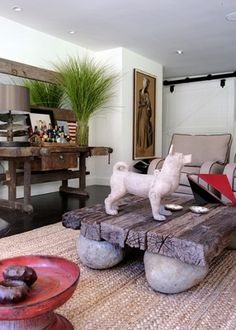 raw-recycled wood furniture. thick panels of old raw wood making coffee table supported by big stones