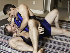 daddies grappling living room floor fighting match
