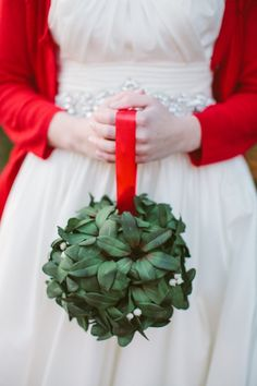 christmas-wedding-bouquet - I've seen it with greenery, red balls, berries, etc. Beautiful!