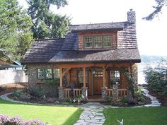 Some day I'd like to own a few acres where I can garden, have room for the kids and grandkids to visit, and enjoy peace and growing older with my sweetie. Doesn't this cottage look charming?