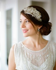 Molly went for a subtle 1920s look, adding earrings that are the groom's family heirlooms and a Jenny Packham headpiece to her ensemble. Get more ideas from this wintry Minnesota wedding online!