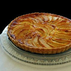 Golden Cream and Apple Tart - Tarte Aux Pommes A La Creme -- Uses only 5 tablespoons of sugar and 3/4 cup creme fraiche. Yum. The apple season is just around the corner.