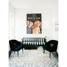 There's something terribly sexy about a black-and-white striped couch (especially one under a Catherine Deneuve Belle de Jour poster).