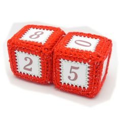 "These blocks can help you count down the days until Christmas!  They an also be used during the whole month of December staring on December 1 through New Years Eve.  They are made with 2"" x 2"" x 2"" little gift boxes that have been stuffed with rocks for weight.  The boxes were then covered in clear shipping tape to make them secure and solid."