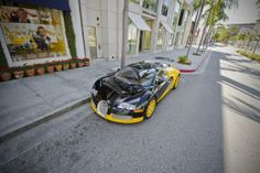 The final treasure that can be found on Rodeo Drive is the work of an automotive designer. Former Bijan owner, Bijan Pakzad's black and yellow Bugatti Veyron is one of the boutique's trademarks. The Bugatti is rotated with his special Bijan edition yellow Rolls Royce, both of which have become permanent fixtures along the street.