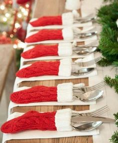 How cute is this table setting? Love the little red and white stockings to hold the silverware!