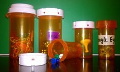 Use empty pill bottles w/ childproof caps to store and organize tiny objects (push pins, game pieces, etc).  Most pharmacies will give them to you for free.  Great for keeping these choking hazards away from children!