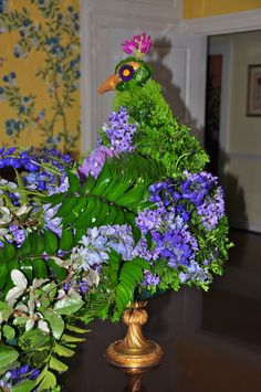 A peacock made out of flowers