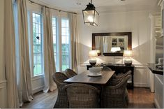 Joni Webb.  In the breakfast room, we added the curtains – four panels to fit in the long bay window with its six windows.  The table was the client's, but we changed out her country French chairs for Kooboos from World Market.
