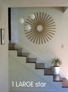 Mod Wall Art: Wallter Retro Starburst; also love the light on dark stair treads.