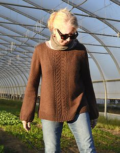 This pattern is available for $6.50 USD   Use the coupon code MEADOW to get $1.00 off this pattern, through October 22, 2014 (EST).  This long-sleeve women's pullover features a pretty twisted-stitch and lace pattern on front and back. The placement of decreases within the center panel gives the appearance of cables, but there are actually no cables in the stitch pattern.