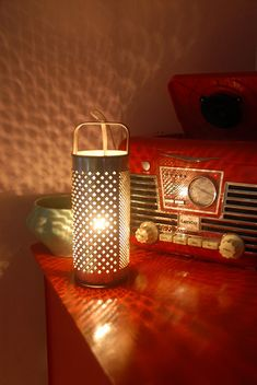 Cheese grater lamp.  Works with candles too.