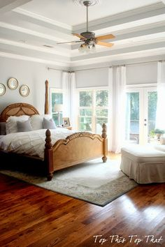 gray bedroom with white bedding and wood bed