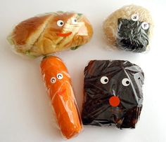 Add eyes and mouth stickers to plastic wrap to make them smile at lunchtime. - like I have time for that but it's sure cute